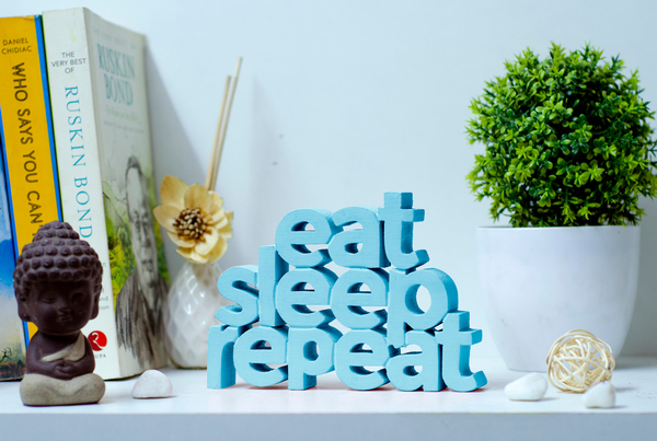 Eat Sleep Repeat wooden tabletop
